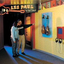 People viewing Les Paul Guitars at Rock Hall